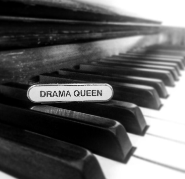Drama Queen badge on a piano